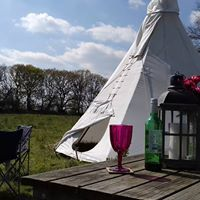 Enjoy a lovely glass of wine whilst relaxing at the luxurious tepee.